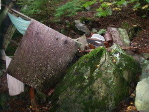 No longer a seat of ease! Our guesthouse outhouse clobbered by falling rock.
