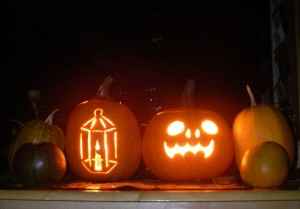 This year's Jack-o-Lanterns, surrounded by pumpkins we grew in the garden.