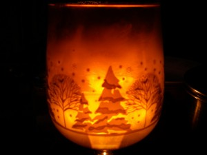 Aly took this photo of a winter wine glass full of cider by candlelight.
