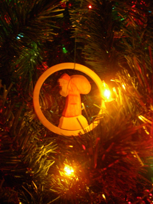 One of our most cherished ornaments from Germany, a simple wooden carving of a weary, traveling Santa.