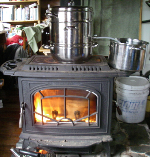The juicer, distilling water on the woodstove (Photo: Mark Zeiger).