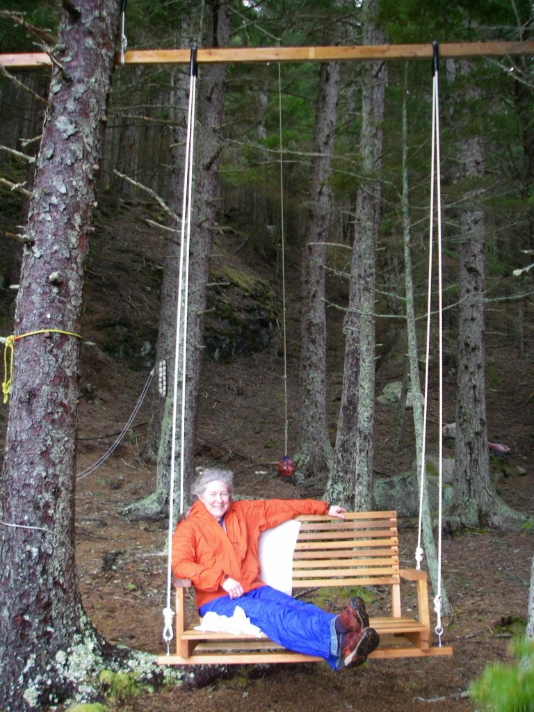Rainpants and paper required, for the moment. Michelle tries out her brand new garden swing (Photo: Mark Zeiger).