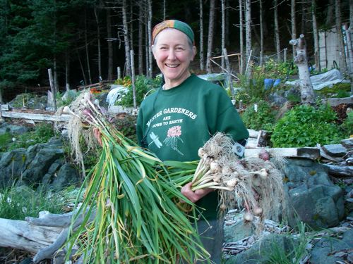 MIchelle holds some of this year's garlic harvest (Photo: Aly Zeiger).