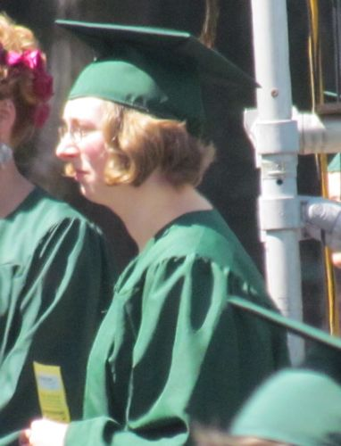 A brief glimpse of the graduate: Aly prepares to cross the Evergreen stage (Photo: Mark A. Zeiger).