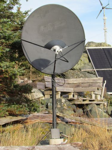 """The satellite dish with the modem """"posed"""" at its base (Photo: Mark A. Zeiger)."""