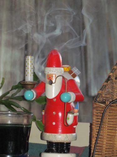 Santa Claus enjoys his pipe (Photo: Mark A. Zeiger).