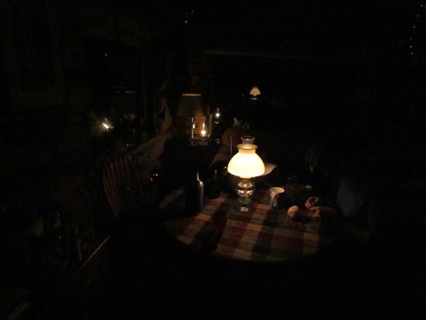 cabin by oil lamp light