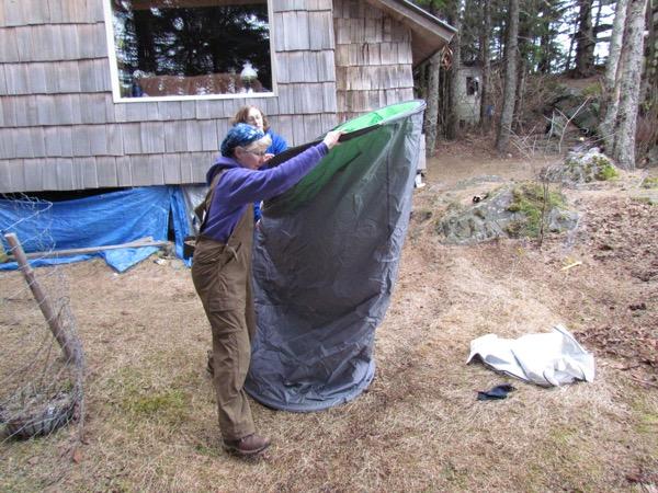 folding a pop-up tent